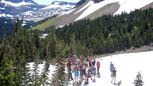 Field Ecology students stand on a Glacier snowfield during a field trip