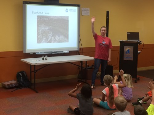 Anne McDarris teaches local children about the Flathead Lake Biological Station at a public library in Polson over the summer