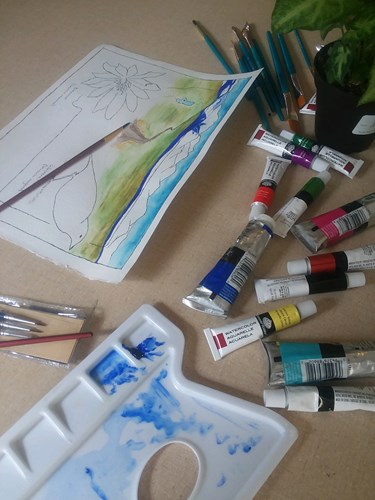 Using art supplies to draw or color an outdoor wildlife scene