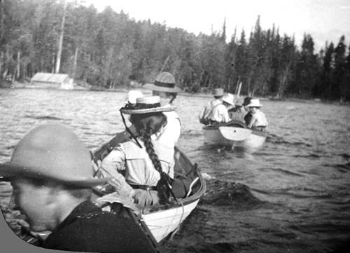 Early students at FLBS canoe across Yellow Bay