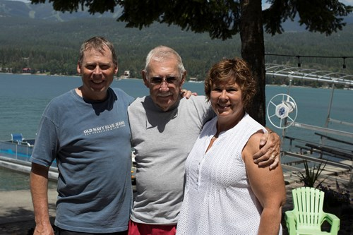 Former FLBS director Dick Solberg stands with his kids Sannon and Jenanne at Whitefish Lake